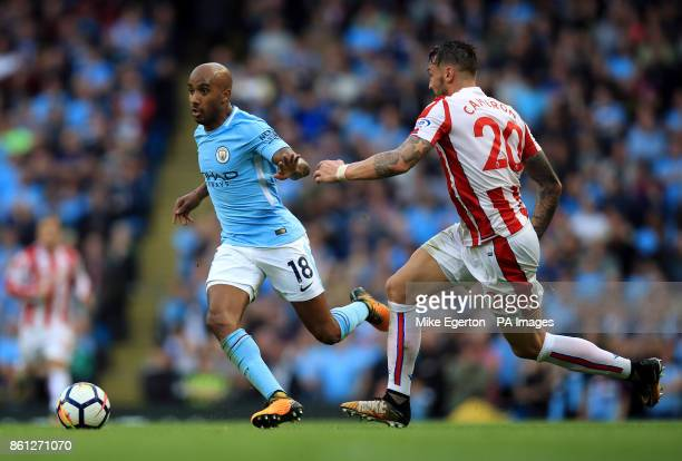 Manchester City's Fabian Delph and Stoke City's Geoff Cameron during the Premier League match at Etihad Stadium Manchester