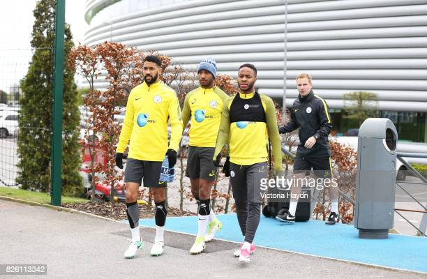 Manchester City's Fabian Delph Gael Clichy and Raheem Sterling during training