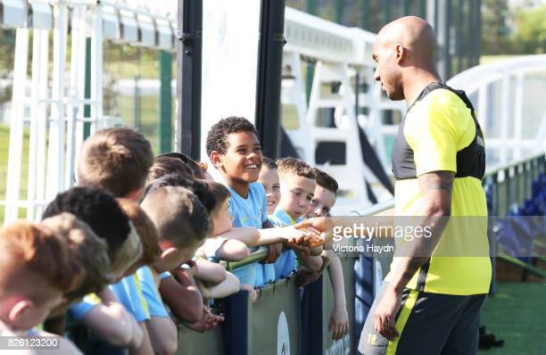 Manchester City's Fabian Delph meets the junior academy players of the club