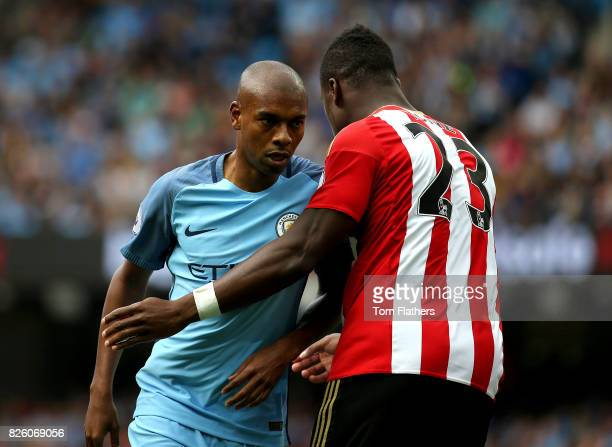 Manchester City's Fernadinho and Sunderland's Lamine Kone in action during the Barclays Premier League match between Manchester City and AFC...