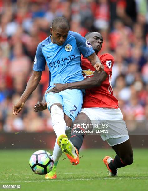 Manchester City's Fernandinho and Manchester United's Eric Bailly battle for the ball