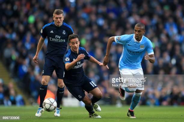 Manchester City's Fernandinho and Real Madrid's Lucas Vazquez battle for the ball