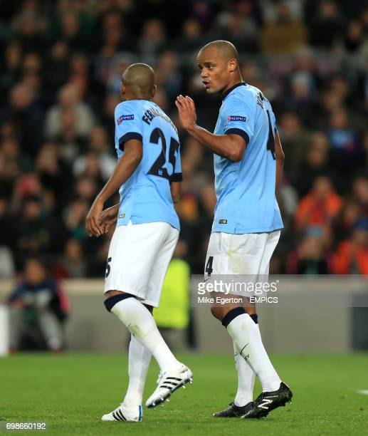 Manchester City's Fernandinho and Vincent Kompany discuss tactics