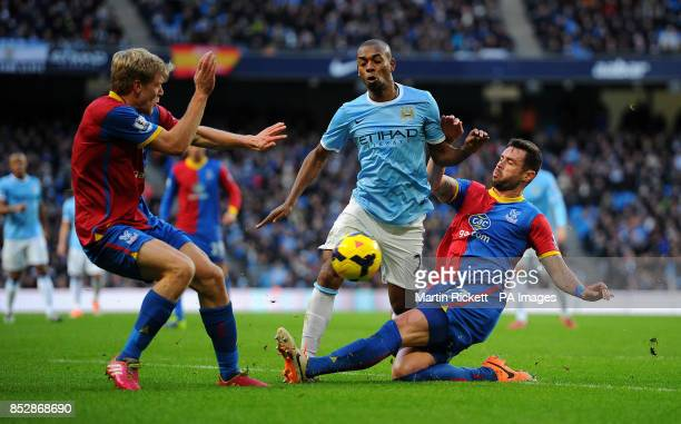 Manchester City's Fernandinho battles for the ball with Crystal Palace Damien Delaney and Jonathan Parr during the Barclays Premier League match at...