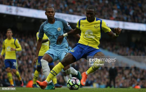 Manchester City's Fernandinho is challenged by Yannick Bolasie