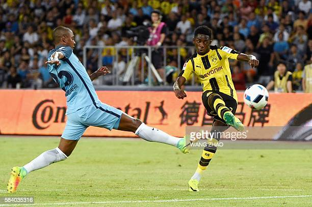 Manchester City's Fernandinho Luiz Roza fights for the ball with Borussia Dortmund's Ousmane Dembele during the 2016 International Champions Cup...