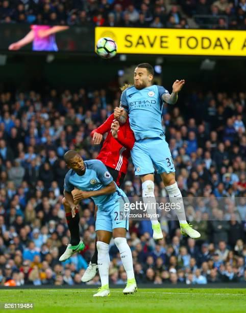 Manchester City's Fernandinho Manchester United's Marouane Fellaini and Manchester City's Nicolas Otamendi battle for the ball in the air