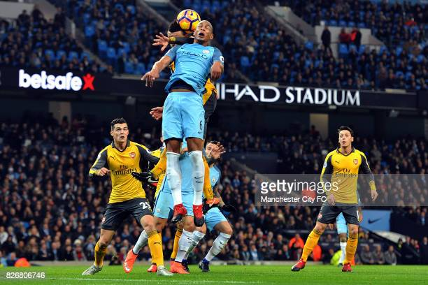 Manchester City's Fernando and Arsenal's Francis Coquelin in action during the Barclay's Premiership match at the Etihad Stadium Manchester on 18th...
