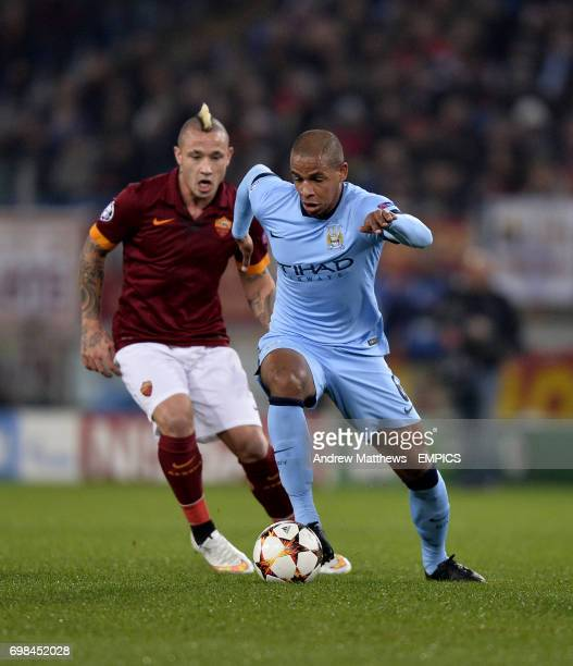 Manchester City's Fernando and AS Roma's Radja Nainggolan battle for the ball