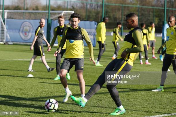 Manchester City's Fernando and Manchester City's Jesus Navas in action during training