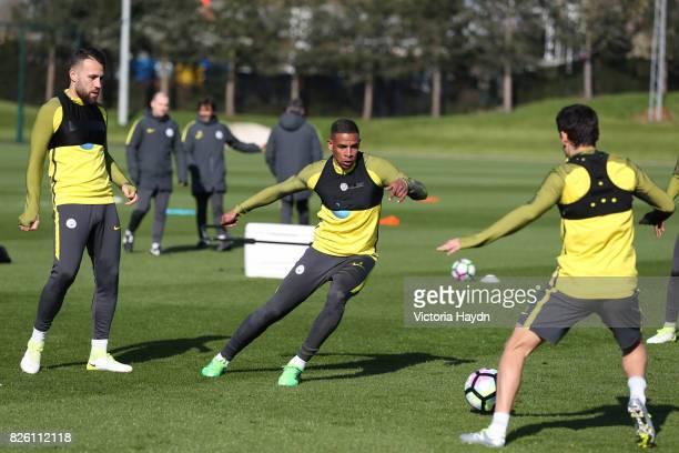 Manchester City's Fernando and Manchester City's Nicolas Otamendi