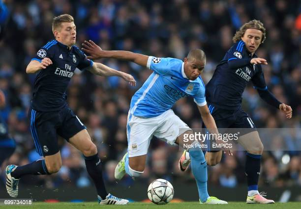 Manchester City's Fernando holds off Real Madrid's Toni Kroos and Luka Modric