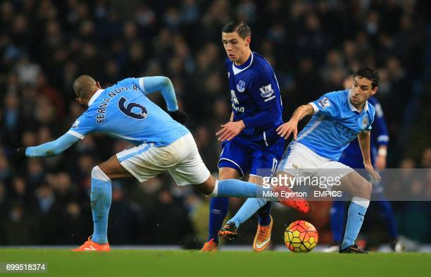 Manchester City's Fernando Reges and Jesus Navas battle for the ball with Everton's Muhamed Besic