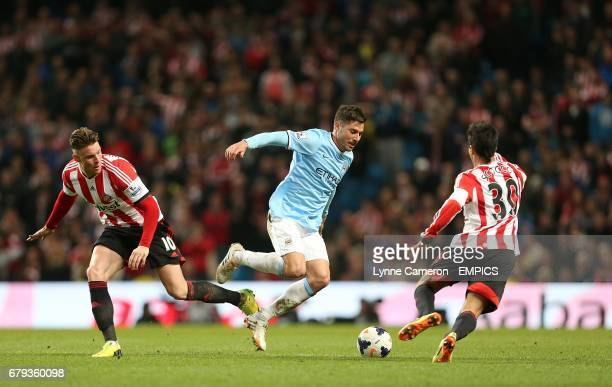 Manchester City's Francisco Javi Garcia battles for the ball with Sunderland's Connor Wickham and Ignacio Scocco