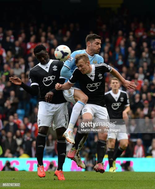 Manchester City's Francisco Javi Garcia battles for the ball with Southampton's James WardProwse and Victor Wanyama