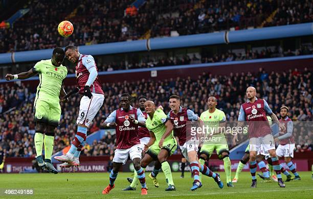 Manchester City's French defender Bacary Sagna jumps for a header with Aston Villa's Ghanian striker Jordan Ayew during the English Premier League...