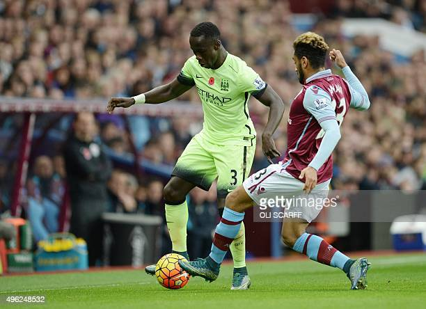 Manchester City's French defender Bacary Sagna vies with Aston Villa's French defender Jordan Amavi during the English Premier League football match...