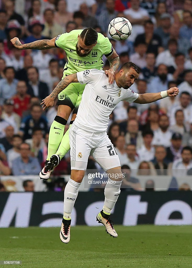 Manchester City's French defender Bacary Sagna (L) vies with Real Madrid's forward Jese Rodriguez during the UEFA Champions League semi-final second leg football match Real Madrid CF vs Manchester City FC at the Santiago Bernabeu stadium in Madrid, on May 4, 2016. / AFP / CESAR