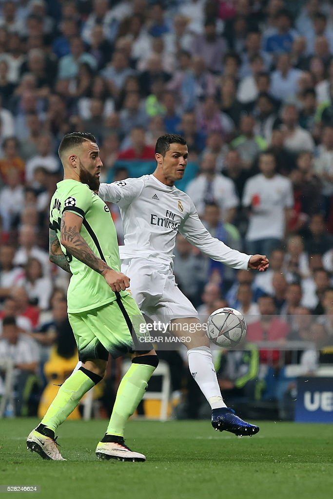 Manchester City's French defender Bacary Sagna (L) vies with Real Madrid's Portuguese forward Cristiano Ronaldo during the UEFA Champions League semi-final second leg football match Real Madrid CF vs Manchester City FC at the Santiago Bernabeu stadium in Madrid, on May 4, 2016. / AFP / CESAR