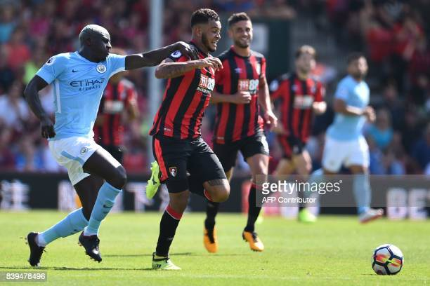 Manchester City's French defender Benjamin Mendy holds back Bournemouth's Norwegian striker Joshua King during the English Premier League football...