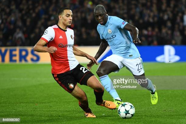 Manchester City's French defender Benjamin Mendy vies for the ball with Feyenoord's Moroccan midfielder Sofyan Amrabat during the UEFA Champions...