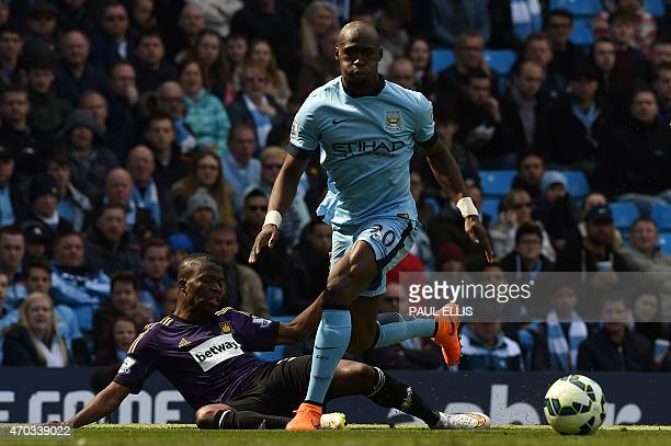 Manchester City's French defender Eliaquim Mangala beats West Ham United's Cameroonian midfielder Alex Song during the English Premier League...