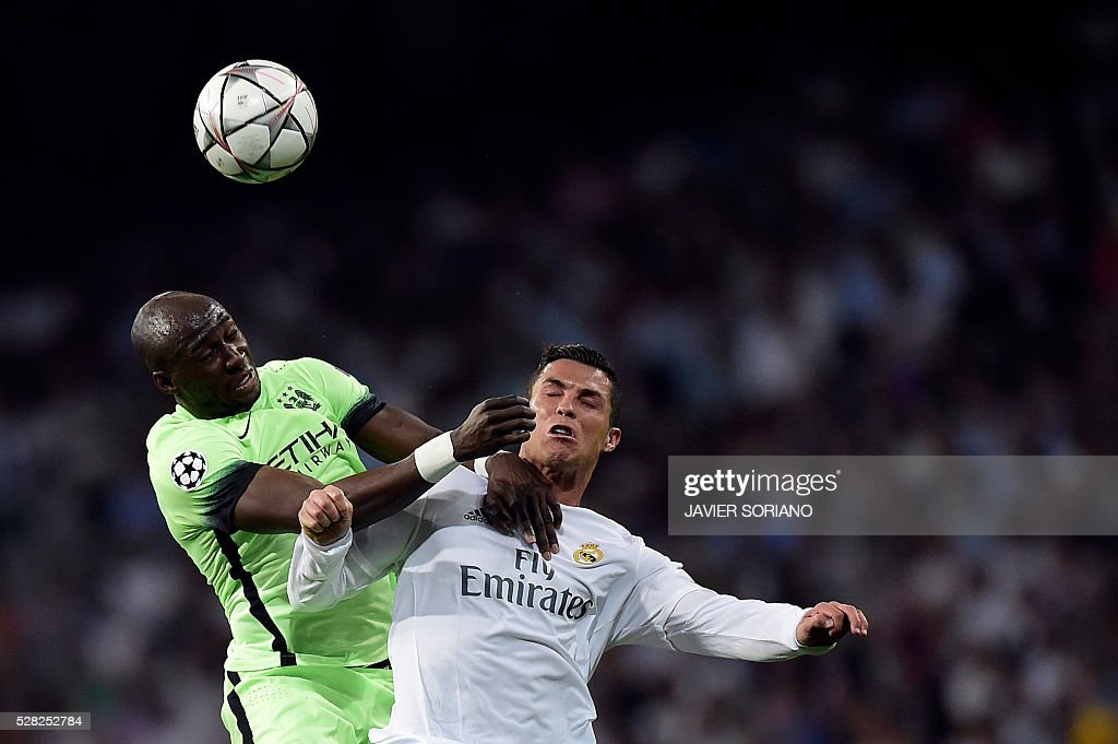 Manchester City's French defender Eliaquim Mangala (L) vies with Real Madrid's Portuguese forward Cristiano Ronaldo during the UEFA Champions League semi-final second leg football match Real Madrid CF vs Manchester City FC at the Santiago Bernabeu stadium in Madrid, on May 4, 2016. / AFP / JAVIER