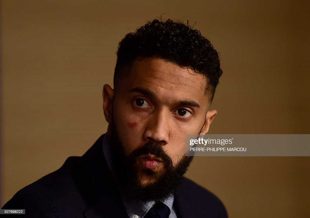 Manchester City's French defender Gael Clichy listens to a question during a press conference at the Santiago Bernabeu stadium in Madrid on May 3, 2016 on the eve of their Champions League semi-final second leg football match against Real Madrid. / AFP / PIERRE