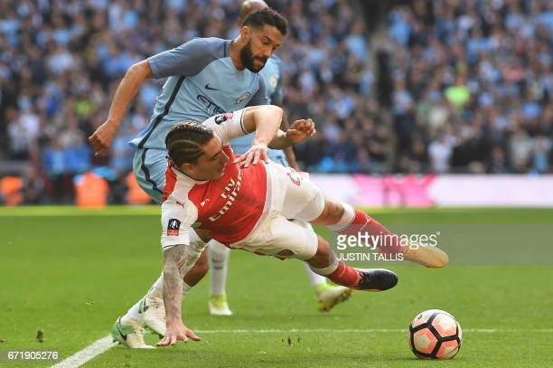 Manchester City's French defender Gael Clichy tackles Arsenal's Spanish defender Hector Bellerin during the FA Cup semifinal football match between...