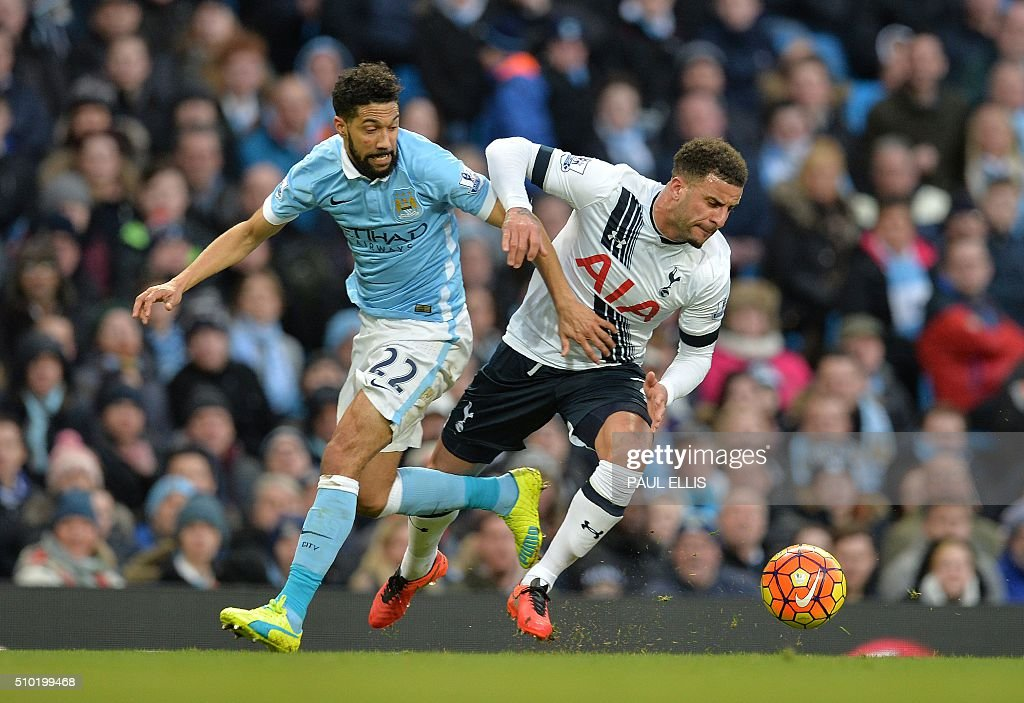 Manchester City's French defender Gael Clichy (L) vies with Tottenham Hotspur's English defender Kyle Walker during the English Premier League football match between Manchester City and Tottenham Hotspur at the Etihad Stadium in Manchester, north west England, on February 14, 2016. / AFP / PAUL ELLIS / RESTRICTED TO EDITORIAL USE. No use with unauthorized audio, video, data, fixture lists, club/league logos or 'live' services. Online in-match use limited to 75 images, no video emulation. No use in betting, games or single club/league/player publications. /