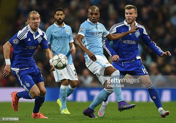 Manchester City's French defender Gael Clichy watches as Manchester City's Brazilian midfielder Fernandinho vies with Dynamo Kiev's Croatian defender...