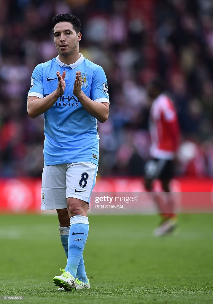 Manchester City's French midfielder Samir Nasri applauds fans after the English Premier League football match between Southampton and Manchester City at St Mary's Stadium in Southampton, southern England on May 1, 2016. / AFP / BEN STANSALL / RESTRICTED TO EDITORIAL USE. No use with unauthorized audio, video, data, fixture lists, club/league logos or 'live' services. Online in-match use limited to 75 images, no video emulation. No use in betting, games or single club/league/player publications. /