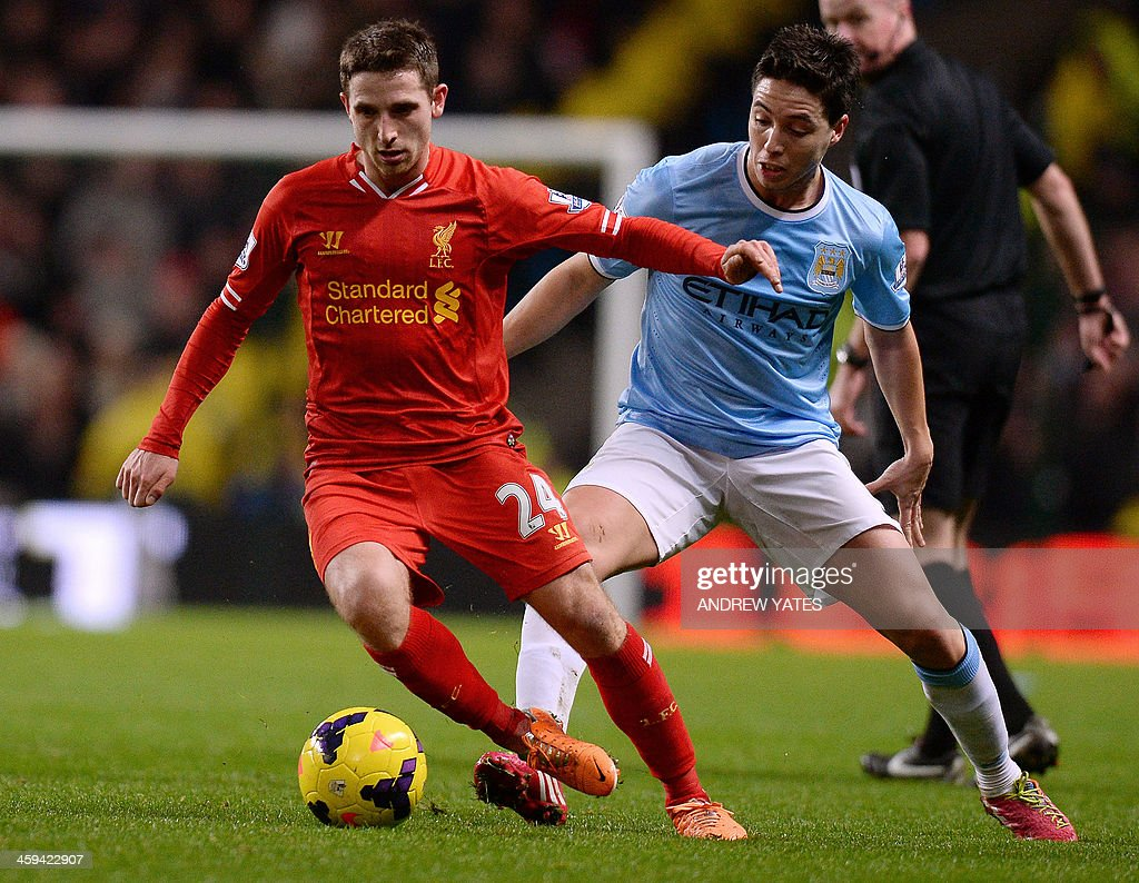 Manchester City's French midfielder Samir Nasri (R) vies with Liverpool's Welsh midfielder Joe Allen during the English Premier League football match between Manchester City and Liverpool at Etihad Stadium in Manchester, northwest England on December 26, 2013. Manchester City won 2-1. USE. No use with unauthorized audio, video, data, fixture lists, club/league logos or live services. Online in-match use limited to 45 images, no video emulation. No use in betting, games or single club/league/player publications.