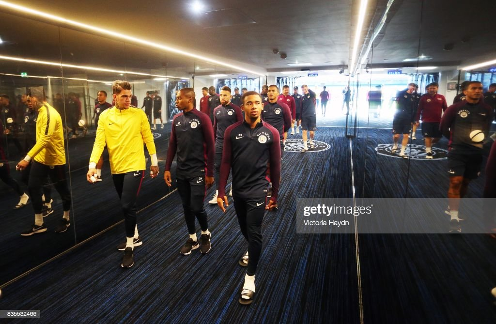 Manchester City's Gabriel Jesus, Fernandinho and Ederson Moraes walk down the new glass tunnel for the first time at Etihad Stadium on August 19, 2017 in Manchester, England.