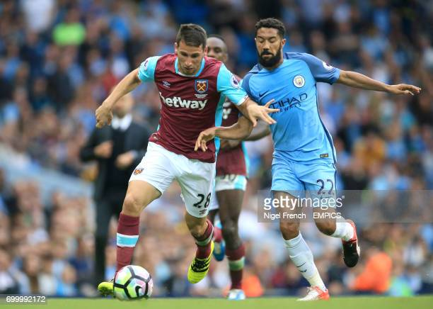 Manchester City's Gael Clichy and West Ham United's Jonathan Calleri battle for the ball