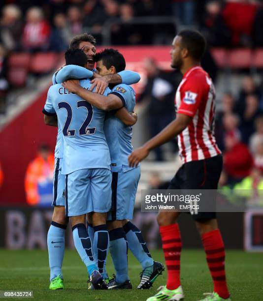 Manchester City's Gael Clichy celebrates scoring his side's third goal with Sergio Aguero and Martin Demichelis