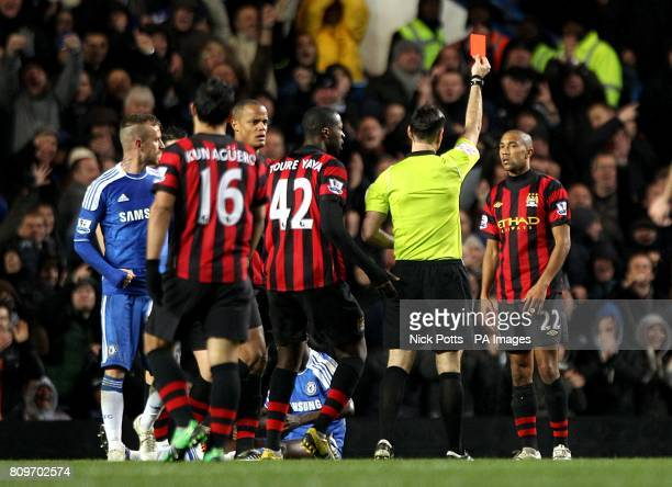 Manchester City's Gael Clichy is shown a red card by referee Mark Clattenburg after his second yellow card for a challenge on Chelsea's Ramires