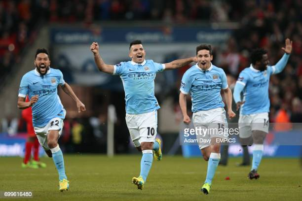 Manchester City's Gael Clichy Sergio Aguero and Jesus Navas celebrate victory in the penalty shoot out