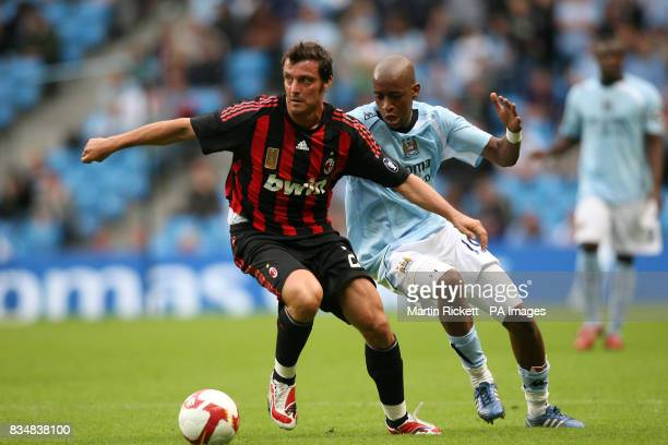 Manchester City's Gelson Fernandes and AC Milan's Massimo Oddo battle for the ball