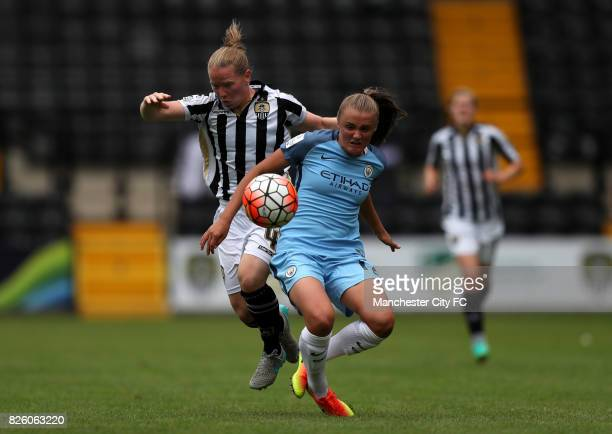 Manchester City's Georgia Stanway and Notts County's Dani Buet battle for the ball