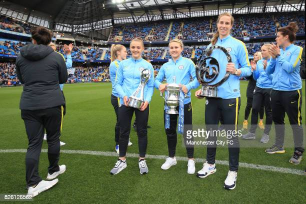 Manchester City's Georgia Stanway Manchester City's Izzy Christiansen and Manchester City's Karen Bardsley with the FA WSL Cup SSE FA Cup final and...