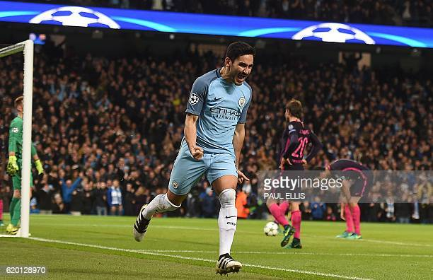 Manchester City's German midfielder Ilkay Gundogan celebrates scoring his team's first goal during the UEFA Champions League group C football match...