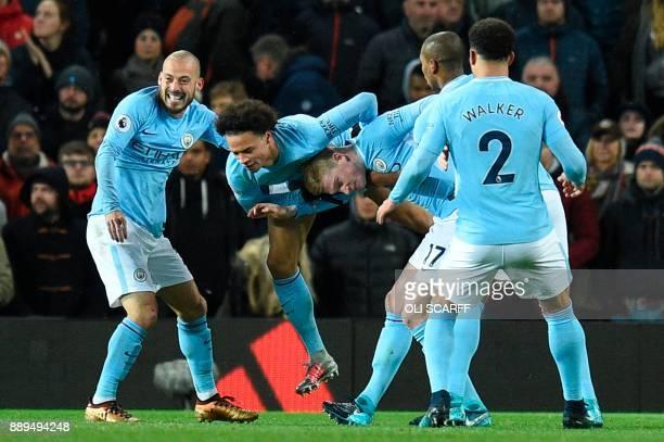 Manchester City's German midfielder Leroy Sane and Manchester City's Belgian midfielder Kevin De Bruyne celebrate after Manchester City's Spanish...