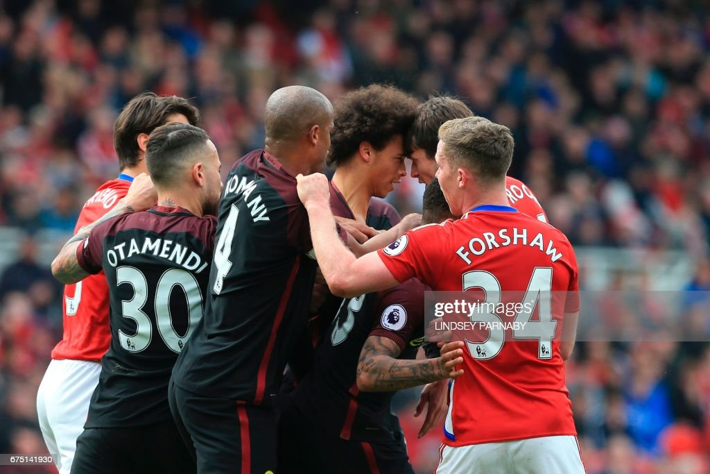 Manchester City's German midfielder Leroy Sane (3R) and Middlesbrough's Dutch midfielder Marten de Roon (2R) confront each other during the English Premier League football match between Middlesbrough and Manchester City at Riverside Stadium in Middlesbrough, northeast England on April 30, 2017. / AFP PHOTO / Lindsey PARNABY / RESTRICTED TO EDITORIAL USE. No use with unauthorized audio, video, data, fixture lists, club/league logos or 'live' services. Online in-match use limited to 75 images, no video emulation. No use in betting, games or single club/league/player publications. /