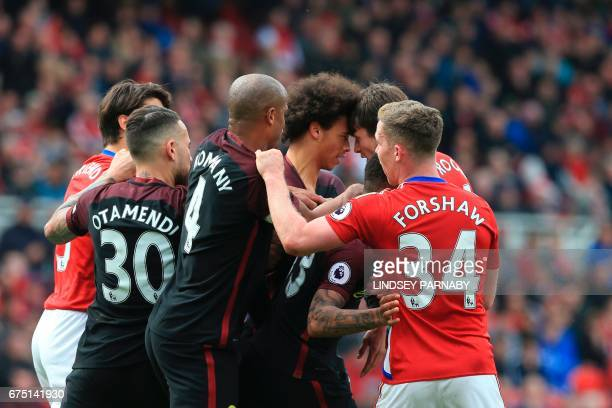 Manchester City's German midfielder Leroy Sane and Middlesbrough's Dutch midfielder Marten de Roon confront each other during the English Premier...