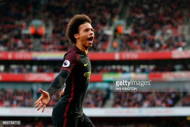 Manchester City's German midfielder Leroy Sane celebrates after scoring the opening goal of the English Premier League football match between Arsenal...