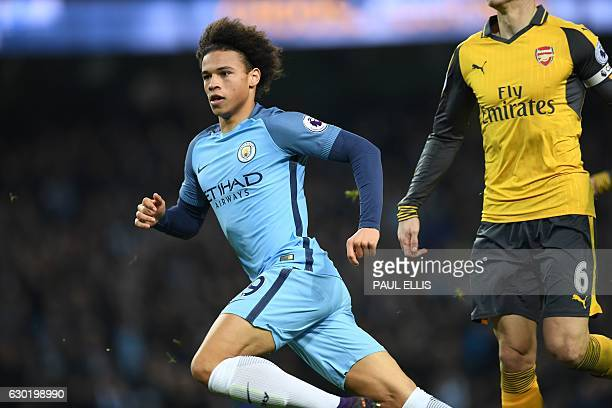 Manchester City's German midfielder Leroy Sane celebrates after scoring their first goal during the English Premier League football match between...