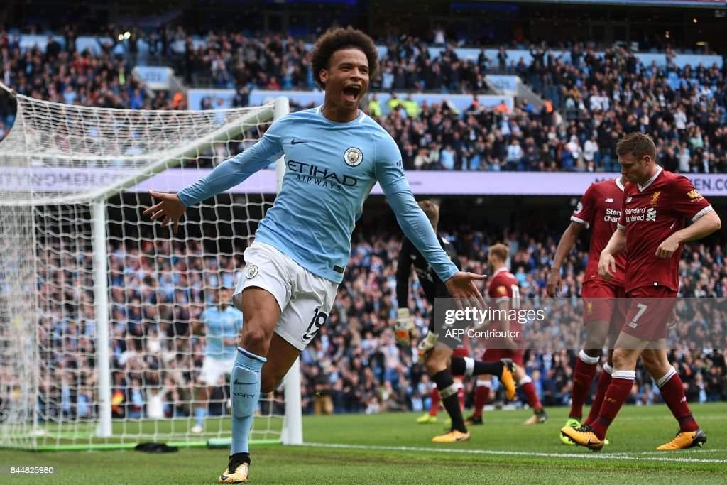 TOPSHOT - Manchester City's German midfielder Leroy Sane celebrates after scoring their fourth goal during the English Premier League football match between Manchester City and Liverpool at the Etihad Stadium in Manchester, north west England, on September 9, 2017. / AFP PHOTO / Oli SCARFF / RESTRICTED TO EDITORIAL USE. No use with unauthorized audio, video, data, fixture lists, club/league logos or 'live' services. Online in-match use limited to 75 images, no video emulation. No use in betting, games or single club/league/player publications. /