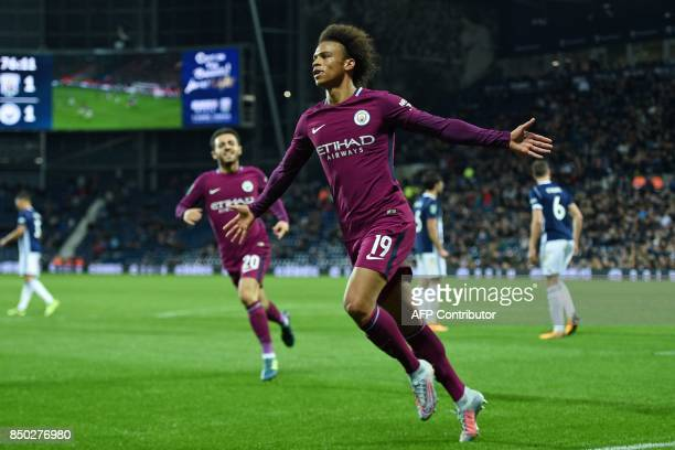 Manchester City's German midfielder Leroy Sane celebrates after scoring their second goal during the English League Cup third round football match...
