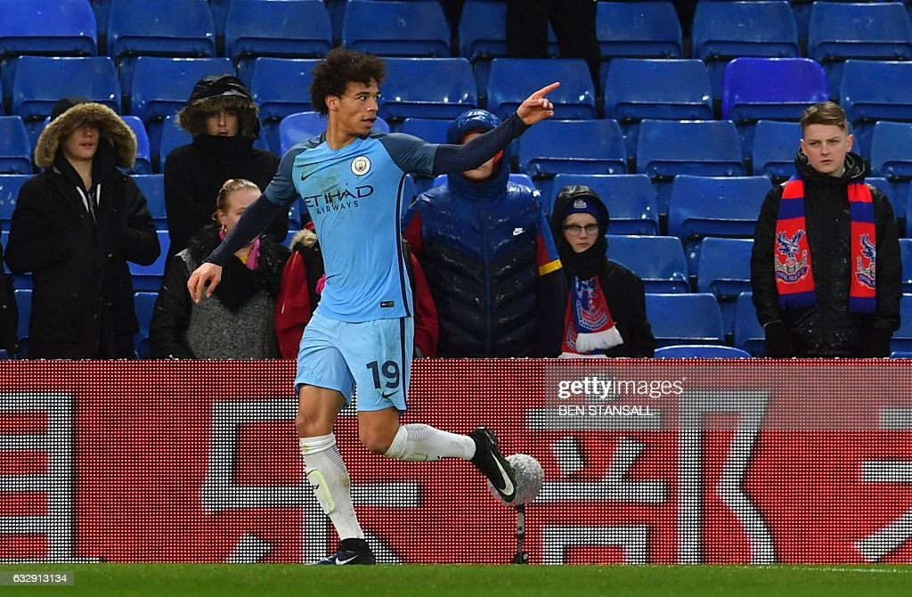 Manchester City's German midfielder Leroy Sane celebrates scoring their second goal during the English FA Cup fourth round football match between Crystal Palace and Manchester City at Selhurst Park in south London on January 28, 2017. / AFP / Ben STANSALL / RESTRICTED TO EDITORIAL USE. No use with unauthorized audio, video, data, fixture lists, club/league logos or 'live' services. Online in-match use limited to 75 images, no video emulation. No use in betting, games or single club/league/player publications. /